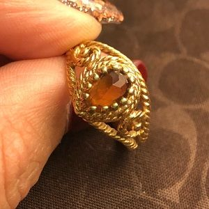Gold ring with yellow/gold stone